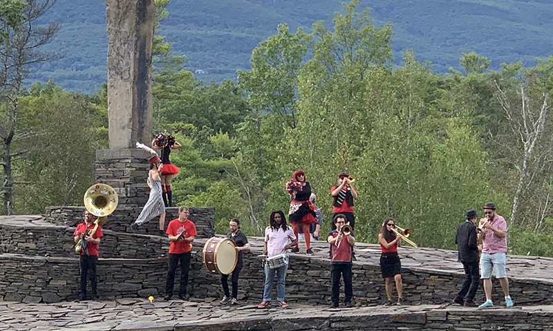 Marching band playing on the Opus 40 monument