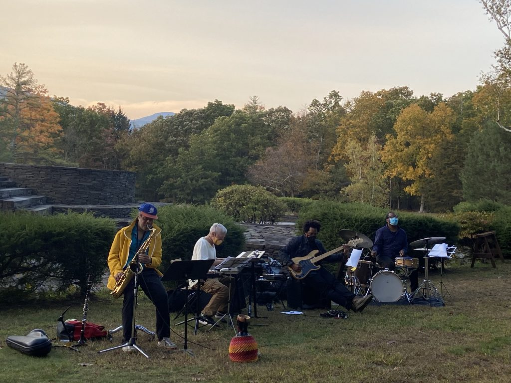 an outdoor social-distance performance at Opus 40